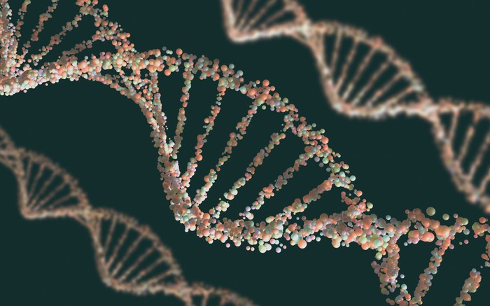 Three strands of a DNA double-helix made up of small multicolored molecules