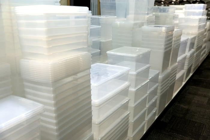 Stacks of clear plastic storage bins.