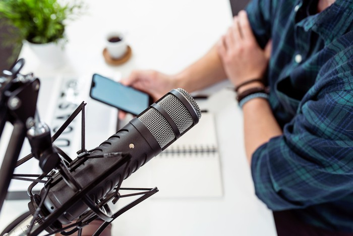 Man recording a podcast with a microphone.
