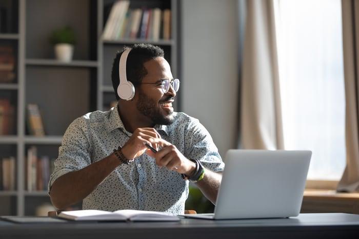 Man listening to podcast through his headphones.