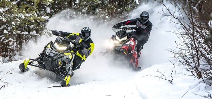 Two snowmobiles racing