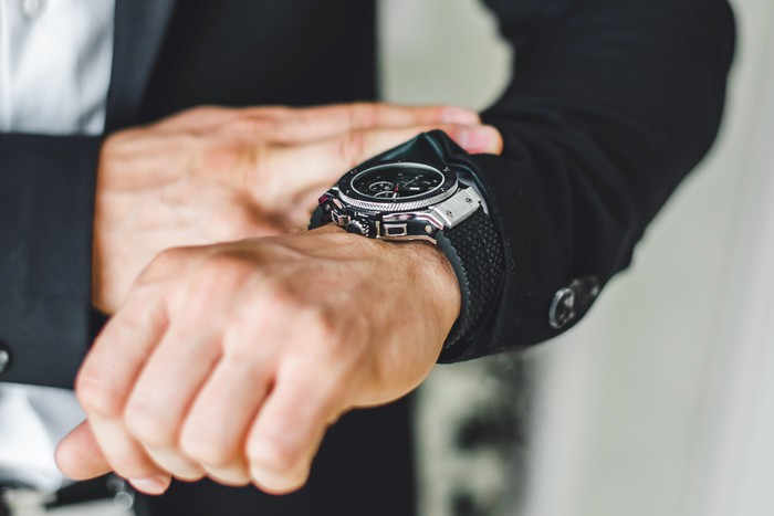 A man looking at his wrist watch