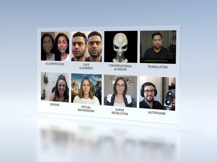 Video conference software displayed on a screen showing people's faces.