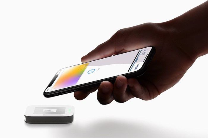 An iPhone being used to make a contactless payment