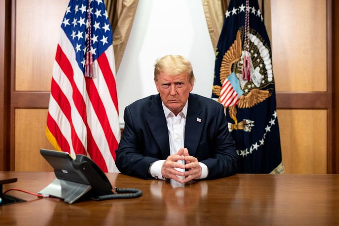 Donald Trump at a desk in Walter Reed Medical Center.