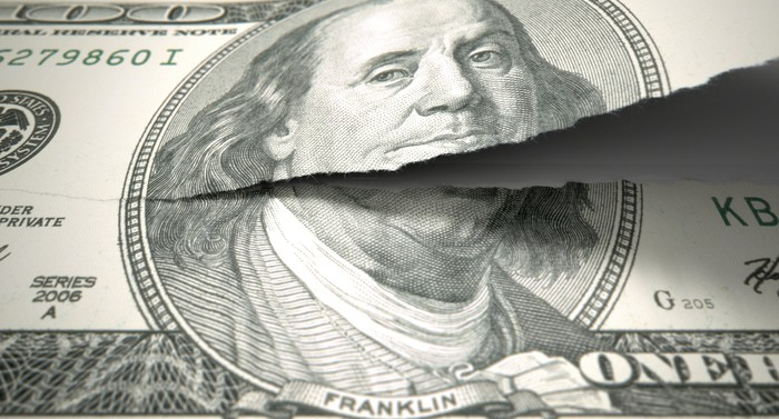 A torn hundred dollar bill.