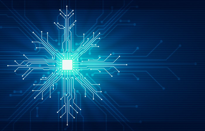 An illustration of sprawling circuits shaped like a snowflake.