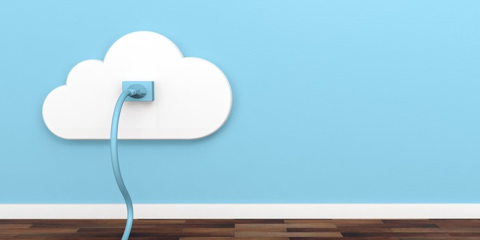 A blue Ethernet cable plugged into a white cloud on a sky blue wall.