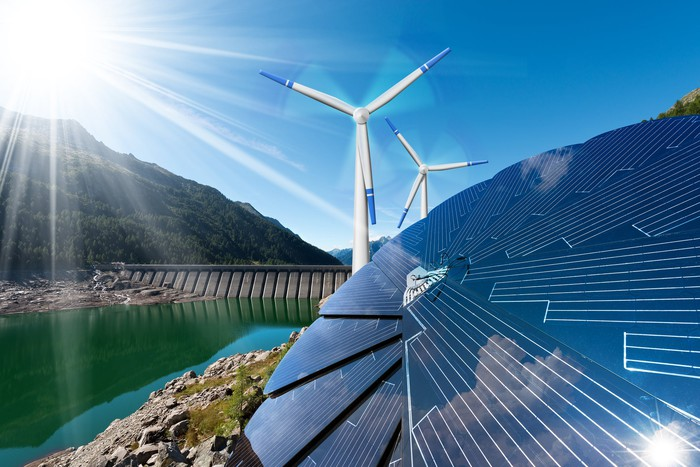 renewable energy including solar panels, wind turbines and hydroelectric dam