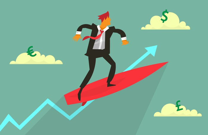 Businessman on surfboard riding a blue arrow pointing up.