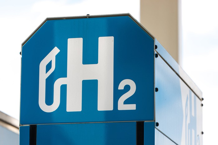 h2 fuel symbol on a large, metal structure.