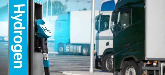 semi trucks at a hydrogen fuel stop