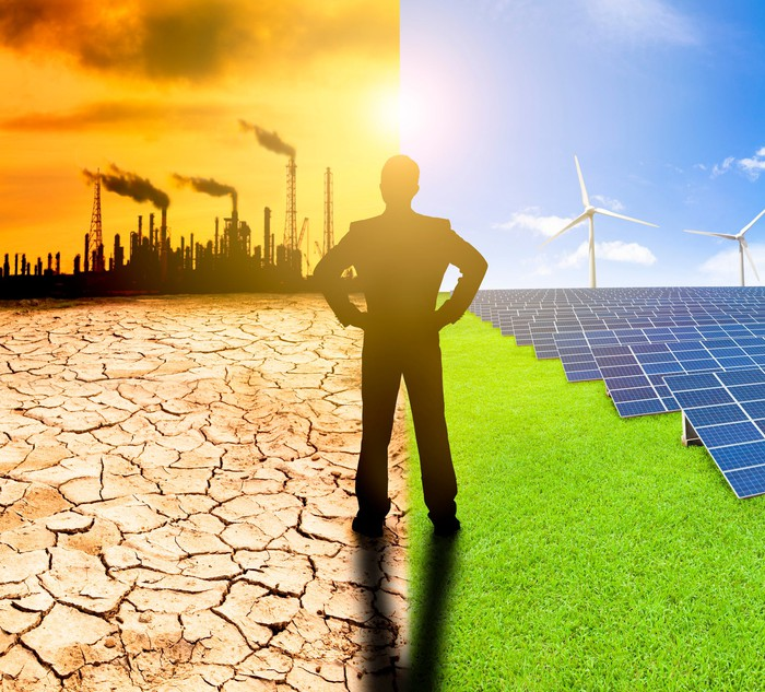 A man standing between a scene of power plants and one with renewable energy resources.