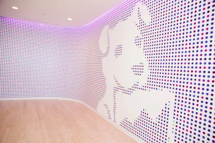 Company image -- image of a white dog on a digital-like background.