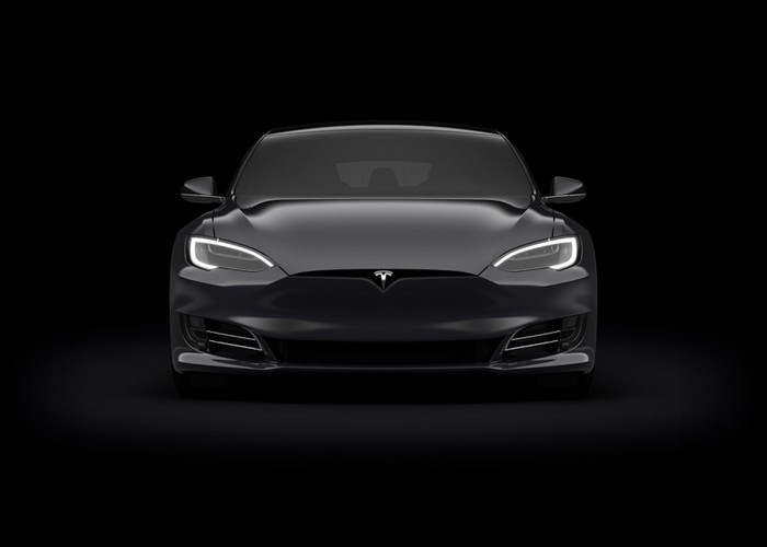 front view of a black Tesla car