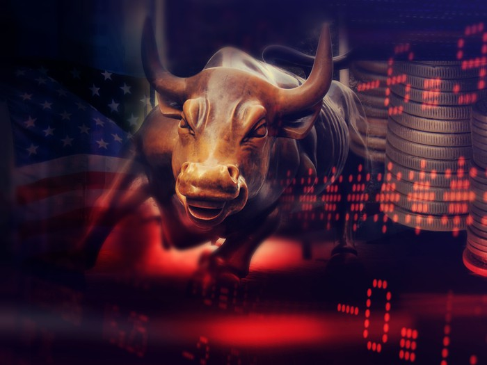 A bull in front of a stock chart.
