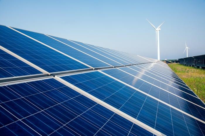 Solar and wind farms with a blue sky