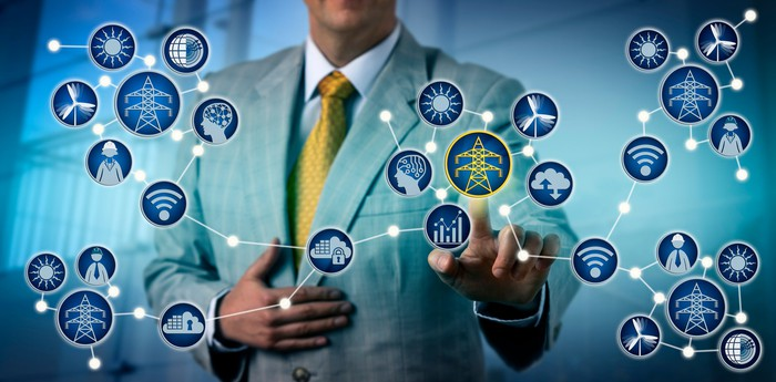 businessman operating electric grid symbols in the cloud in front of him