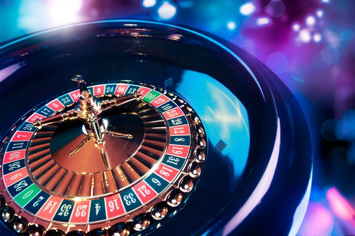 A roulette wheel spins in a casino.