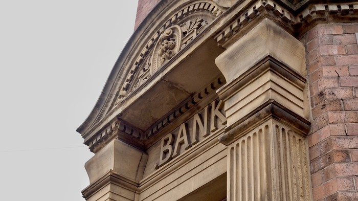 Stone and brick facade of a building with the word BANK on it