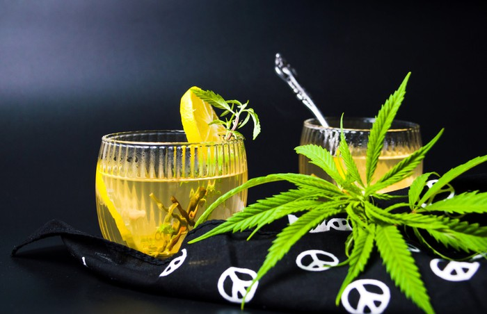 Cannabis tea with marijuana leaves and lemon