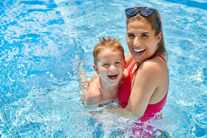 A mother and child in a swimming pool.