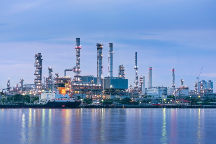 Coastal oil and gas refinery at twilight.