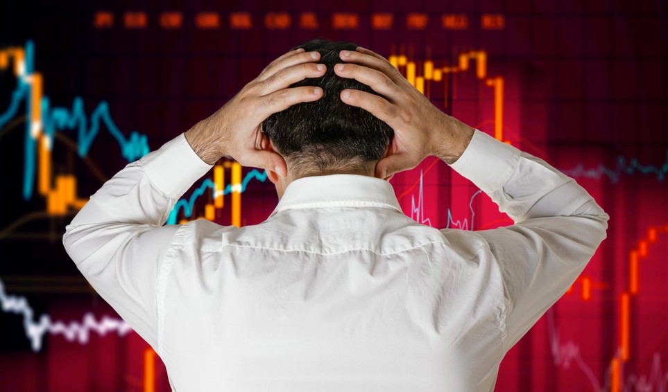 man in white dress shirt looking at chart and putting his hands on his head -- stock broker loss bear market crash