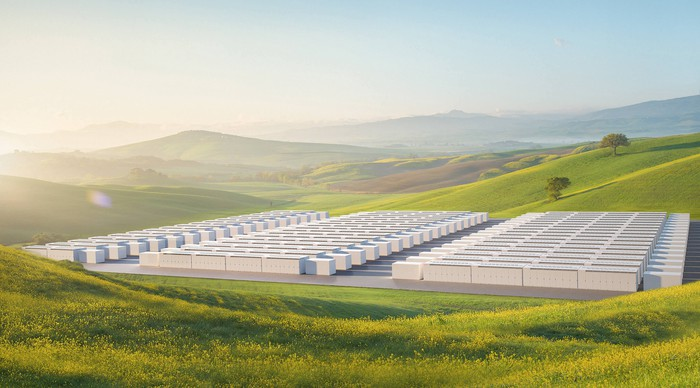 A rendering of Tesla megapacks in a valley.