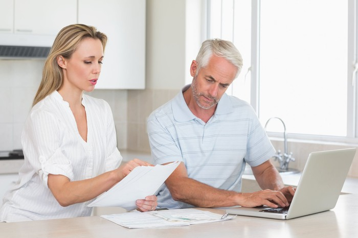 Couple reviewing finances with their laptop at home.