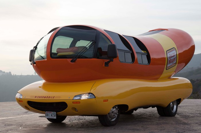 The Oscar Mayer wienermobile parked on the side of a road.