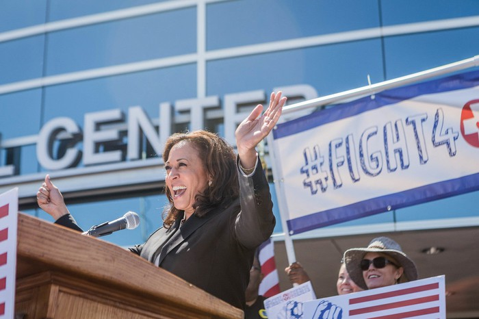 Kamala Harris speaking to a crowd at a healthcare rally.