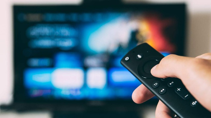 Hand holding Amazon Fire TV  remote control