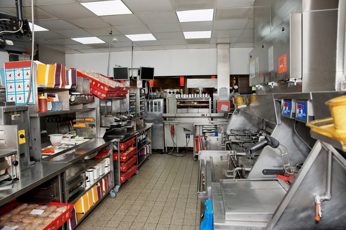 The inside of a fast-food restaurant kitchen.