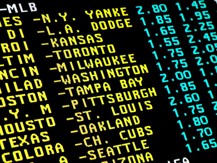 Sports betting lines on a big board.