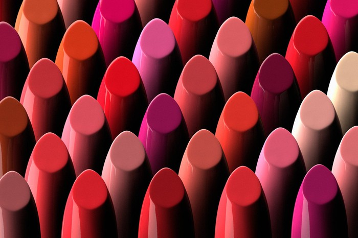 Illustration of numerous lipsticks of varying colors.