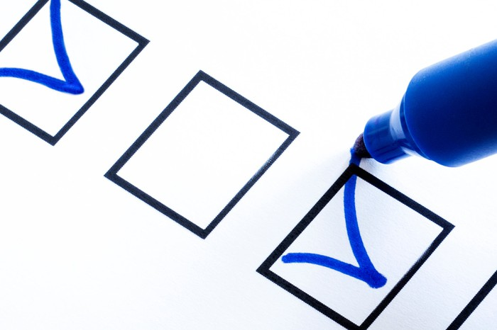 Three checkboxes, with the first containing a blue checkmark, and a blue marker making a checkmark in the third