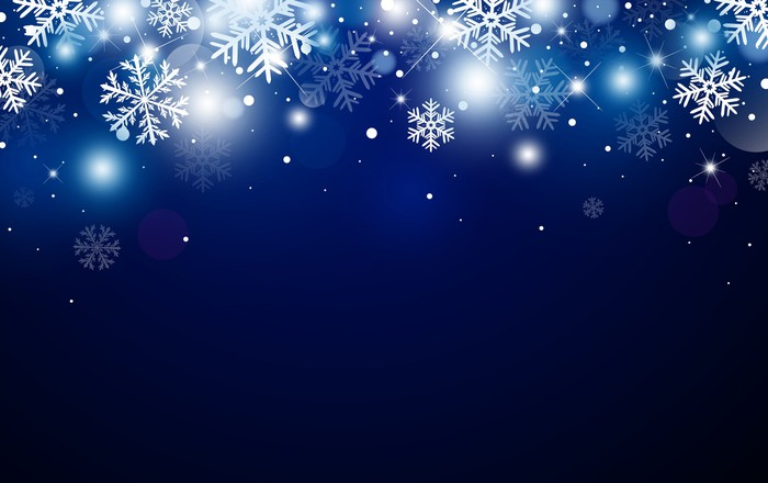 Falling snowflakes against a dark backdrop.