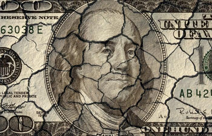 A cracked hundred dollar bill.
