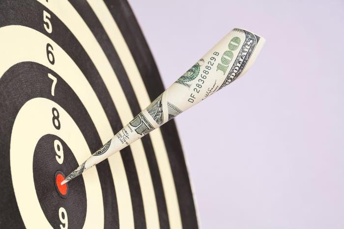Dollar bill used as a dart