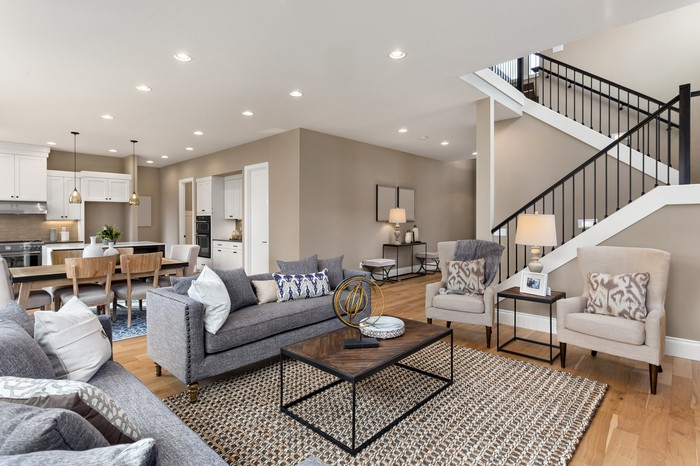 luxurious living room with staircase