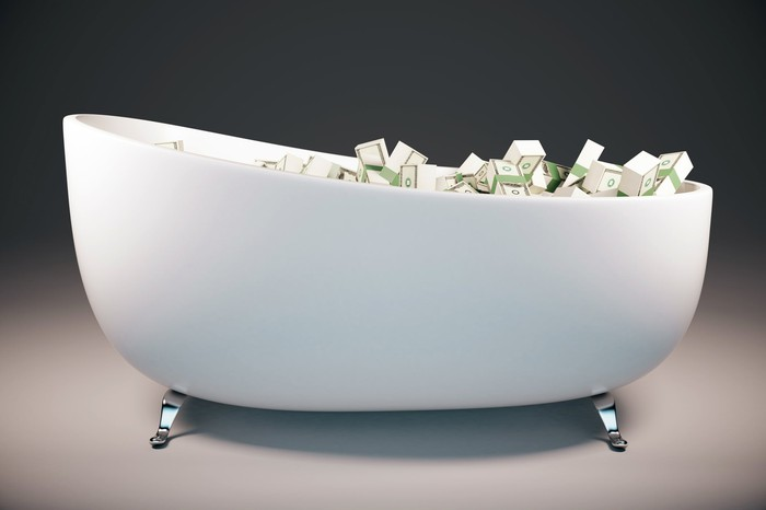 A bathtub full of money.