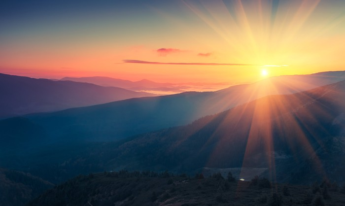 Panoramic view of colorful sunrise in mountains
