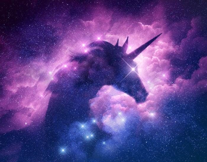 Unicorn silhouette set in a nebula cloud in space