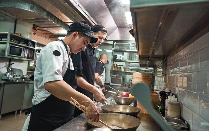 Chefs working in a restaurant kitchen