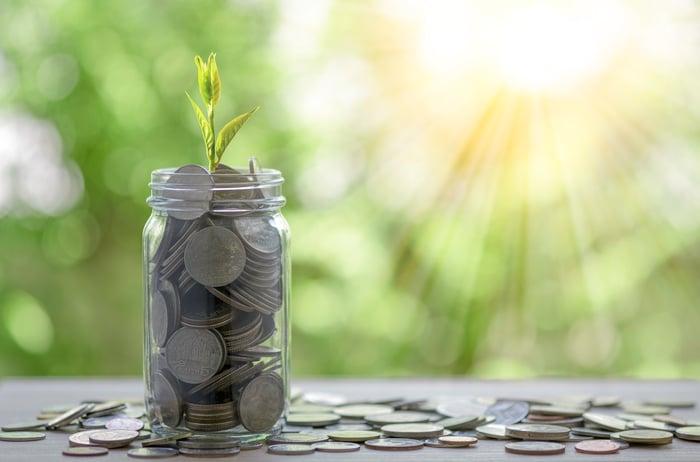 Sun shining on a jar full of coins.