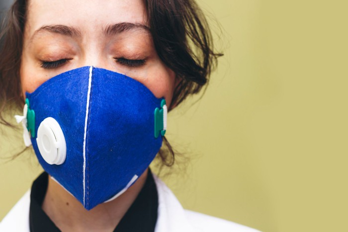 Doctor with closed eyes and mask on