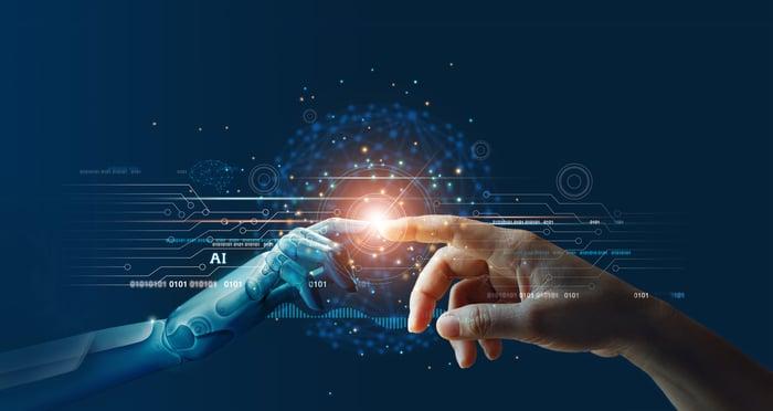 Human finger touching finger of AI-driven robot.