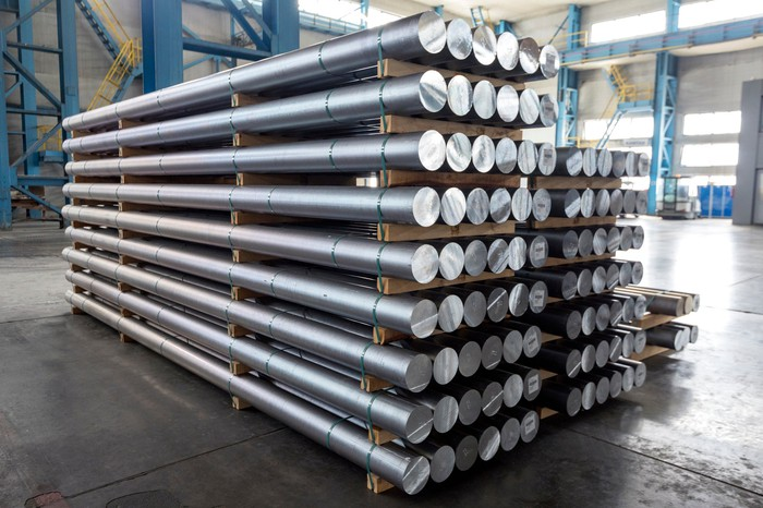 Large rods of aluminum in a warehouse.