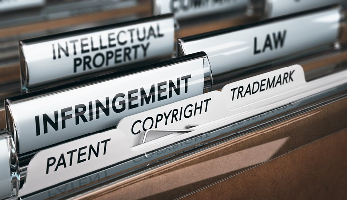 """A filing system with labels including """"Infringement,"""" """"Law,"""" """"Intellectual Property,"""" """"Patent,"""" and similar words."""